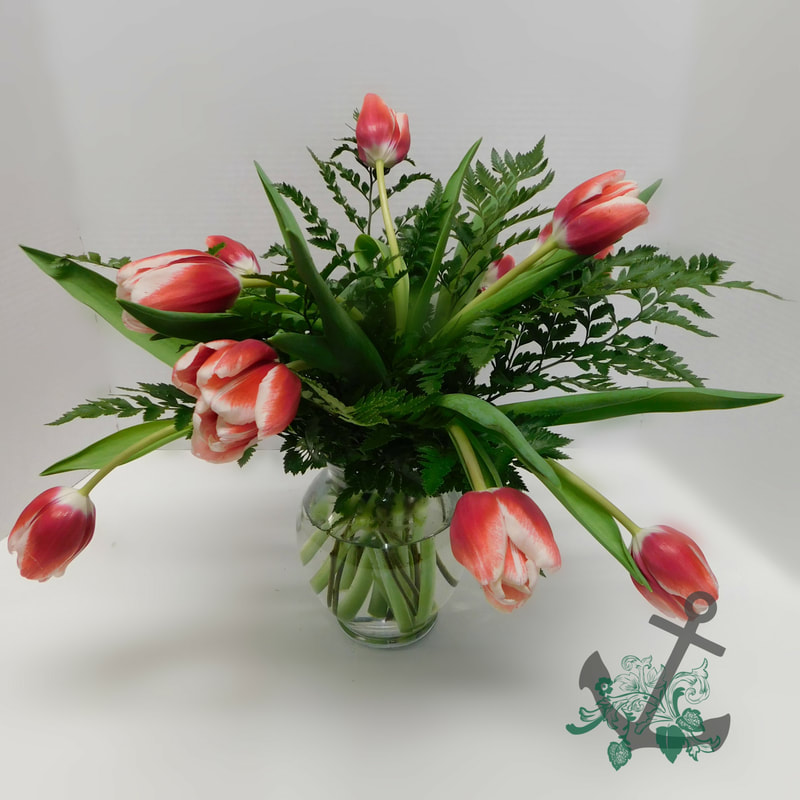 SWEET TREATS SPECIAL ​VDAY-103 $19.95 THREE CARNATIONS WITH GREENS AND BABY'S BREATH IN ​VASE WITH SUCKER